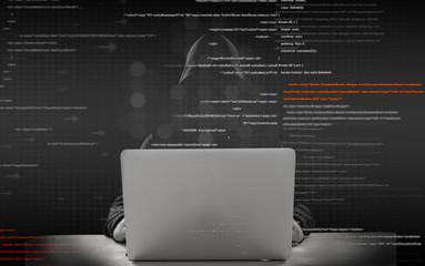 unknown hacker working on laptop