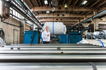 Man in tyre manufacturing plant looking away, Ballenstedt, Germany