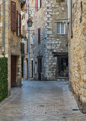 Narrow cobbled street in old village Vence , France.