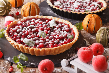 Delicious Christmas cranberry tart and festive decoration close-up. Horizontal