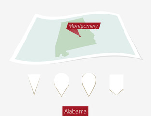 Curved paper map of Alabama state with capital Montgomery on Gray Background. Four different Map pin set.