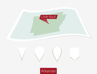 Curved paper map of Arkansas state with capital Little Rock on Gray Background. Four different Map pin set.