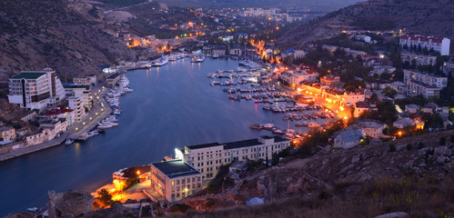 High angle view of cityscape with Balaklava Bay at dusk