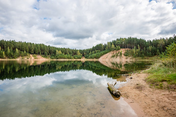 calm lake with reflections of clouds  in summer