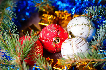 Christmas balls, gift boxes and fir tree branch
