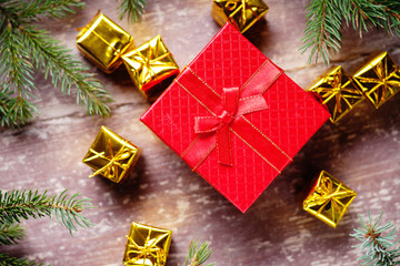 Gift boxes and fir tree branch