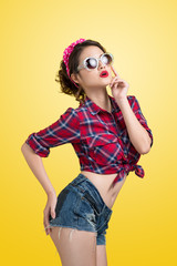 Lovely woman retro portrait  with pin-up make-up and hairstyle w
