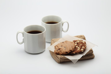 The chocolate cookies and coffee cup set for relax and break from meeting