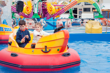 Beautiful children having fun at an amusement park. Children on