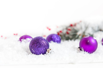 Christmas and New Year decoration. Christmas violet balls on abstract background, soft focus. Coloring and processing photos. Shallow depth of field