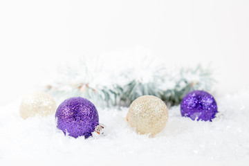 Christmas and New Year decoration. Christmas violet and gold balls on abstract background, soft focus. Coloring and processing photos. Shallow depth of field