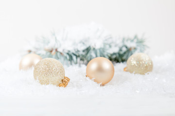 Christmas and New Year decoration. Christmas gold balls on abstract background, soft focus. Coloring and processing photos. Shallow depth of field