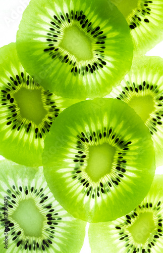 Wall mural sliced Kiwi fruit isolated on white background cutout