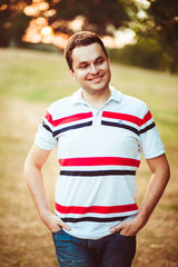 charming portrait of handsome and happy man outdoors