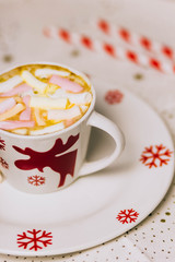 Cup of hot Chocolate drink with Marshmallows and cinnamon on dark wooden background. Winter time. Holiday concept, Selective focus