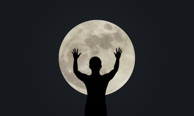 Silhouette man show his hand up with Super full moon night