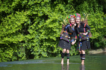 Hmong hill tribe people dressed in costumes, a beautiful city in Laos.