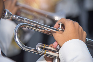 Closeup of trumpet player's hands , Marching Band
