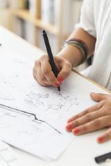 Landscape architect drawing at desk, close-up