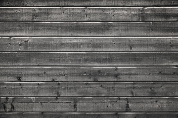 Dark gray old grungy wooden wall