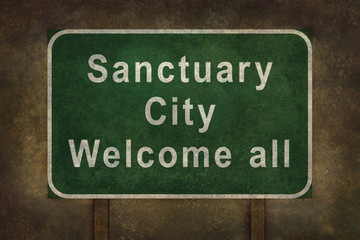 Sanctuary city welcome road sign with ominous background