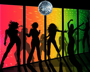 Dancing silhouettes of girls in a nightclub with a shining disco ball