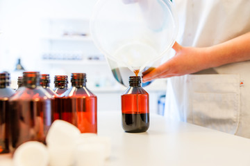 Refilling or cough syrup at a pharmacy
