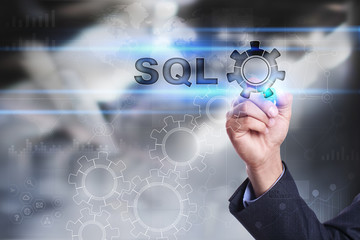Businessman is drawing on virtual screen. sql concept