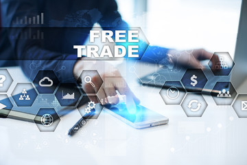 Businessman is working in office, pressing button on virtual screen and selecting free trade