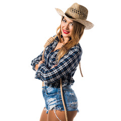 Sexy blonde woman cowgirl with her arms crossed