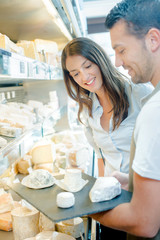 Couple holding a cheese platter