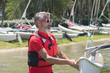 professional waterman training on lake with catamaran