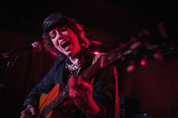 Guitarist performing at a nightclub