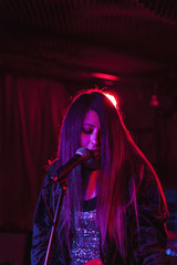 Young woman performing at a club