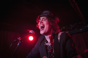 Singer performing at a nightclub