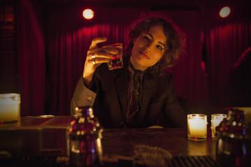 Woman enjoying a drink at a bar