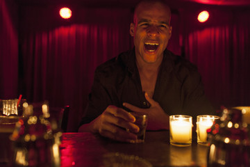 Young man enjoying a drink at a bar