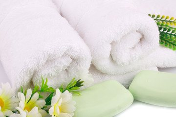 Towel, soaps and flowers