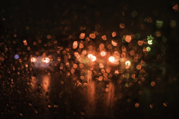 beautiful drops of water on a glass street light at night.