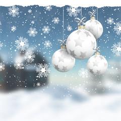 Christmas baubles on a defocussed winter landscape