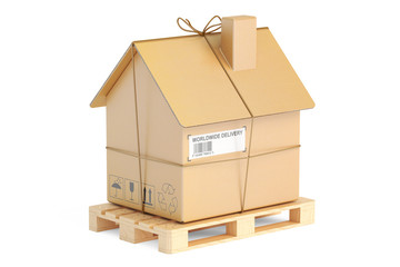 Household moving services concept. Pallet with cardboard house p