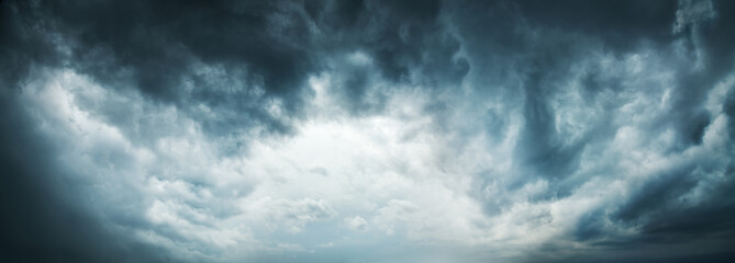 Photo sur cadre textile Ciel Dramatic Sky Background. Stormy Clouds in Dark Sky. Moody Cloudscape. Panoramic Image Can Be Used as Web Banner or Wide Site Header. Toned and Filtered Photo with Copy Space.