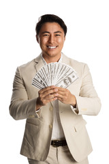 Handsome man in a bright suit with a big smile holding a big fan of 100 dollar bills. White background.