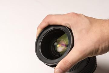 Man hand with black camera lens