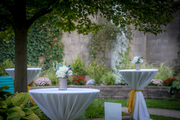 Tables settings for a wedding ceremony outside in garden