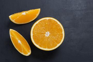 fresh orange fruit on wooden table in black