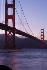 Telescope view of Golden gate bridge in evening at San Francisco bay