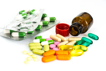 Colored capsules, pills and medical glass bottle