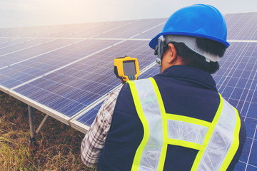 electrician working on maintenance equipment at industry solar p
