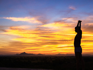 Free happy woman enjoying nature sunset. Freedom, happiness and enjoyment concept of young multiracial Asian